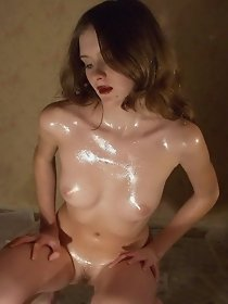 Cute chick shows her oiled naked body